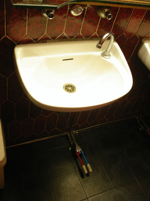 Toilet basin in Italy, with pedals for hot & cold water